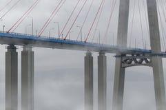 The Russky Bridge Russian Bridge in the fog. The Russky Bridge Russian Bridge is a bridge across the Eastern Bosphorus. Bridge to the Russian Russky island. In stock images