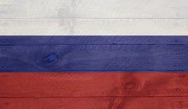 Russland-Flagge auf hölzernen Brettern mit Nägeln Stockfotografie