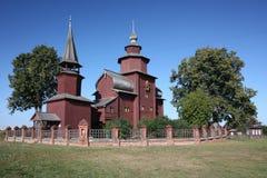 Russland, hölzerne Kirche. Stockbilder