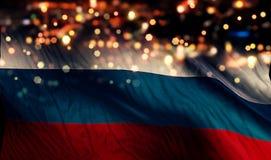 Russland-Staatsflagge-Licht-Nacht-Bokeh-Zusammenfassungs-Hintergrund Lizenzfreie Stockfotografie