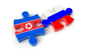 Russsia and North Korea flags on puzzle pieces. Political relati Royalty Free Stock Photos