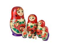 Russsian aninhou as bonecas ajustadas em um fundo branco Imagens de Stock Royalty Free