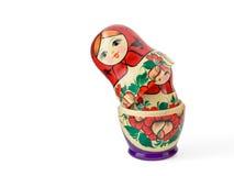 Russsian aninhou as bonecas ajustadas em um fundo branco Fotografia de Stock Royalty Free