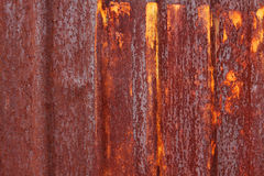 Rust. A rusty corrugated iron metal fence Zinc wall Royalty Free Stock Photography