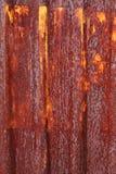 Rust. A rusty corrugated iron metal fence Zinc wall Stock Photography