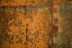 Rust. Detail of rusty metal door, showing rust textures and rivets stock photography