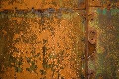 Rust. Detail of rusty metal door, showing rust textures and rivets Stock Photography