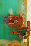 Rust. Metal door and lock with blue paint and rust Stock Photos