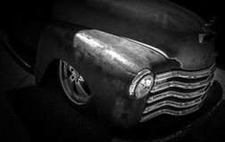 Rust American Retro Muscle Hotrod. Rust american retro classic hotrod on black background with chrome grill and headlight and chrome rims Stock Photo