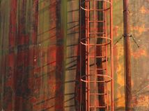 Rust background and texture. Industrial safety ladder on old metal wall completely rusty Royalty Free Stock Images