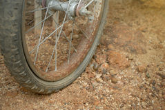 Rust bicycle wheel and flat tyre. Royalty Free Stock Images