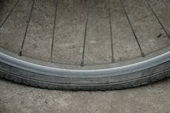 Rust bicycle wheel and flat tyre. Stock Photos