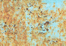 Rust on blue steel background Royalty Free Stock Images