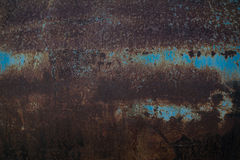 Rust on blue steel. Brown rust on blue steel stock photo