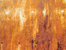 Rust on  brown old painted metal. Royalty Free Stock Photo