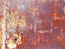 Rust on  brown old painted metal. Royalty Free Stock Image