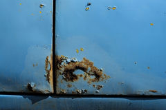 Rust on a car. Rust on the car, rusted on through Royalty Free Stock Photos