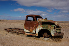 Rust car wreck. A rusty car wreck an remain of the civil way in Namibia royalty free stock photography