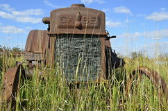 Rust Case tractor in the long grass Royalty Free Stock Photos