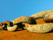 Rust chain. Link on blue sky Royalty Free Stock Photography