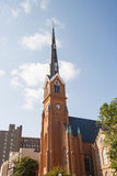 Rust Colored Church Steeple on Nice Sky Royalty Free Stock Photo