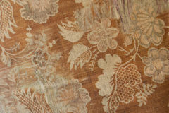 Rust colored cotton fabric with pattern of flowers and leaves Royalty Free Stock Images