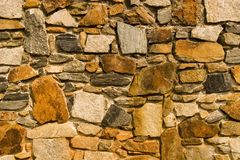 Rust Colored Stone Wall Stock Images