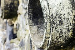 Rust and corrosion in the pipe and metal skin.Corrosion of metal.Rust of metals. Drainage Pipe Water pollution in river because in. Dustrial effluent not treat Royalty Free Stock Images