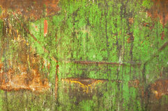 Rust on dirty old green painted metal  Royalty Free Stock Image