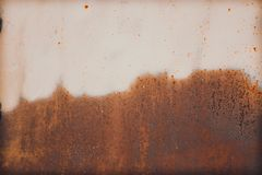 Rust and erosion on metal sheet half area surface royalty free stock image