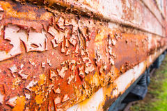 Rust and flaking paint on abandoned tain car Royalty Free Stock Photo