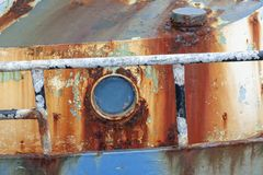 Rust and flaking paint on fishing boat royalty free stock photo