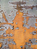 Rust with Flaky Paint Accents. A vibrant sunlit piece of rusty metal with flaky paint accents Stock Photos
