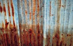 Rust. On the galvanized fence Stock Photo