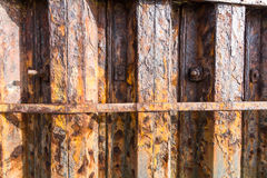 Rust iron girders forming part of harbour wall. Royalty Free Stock Photography