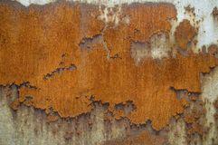 Rust on iron plate. Steel plate with large rusty scalings shaped like a map Stock Image