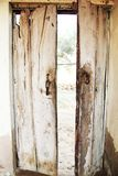 Rust Lock of Old Wooden Gates. royalty free stock photos