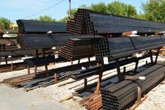 Rust metal quadratic profile lies in heap Stock Images