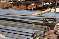 Rust metal quadratic profile lies in heap Royalty Free Stock Photo