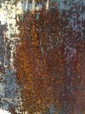 Rust on metal surface covered with paint. Rust on metal surface covered with peeling paint Stock Image