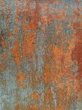Rust on metal surface covered with paint. Rust on metal surface covered with peeling paint Royalty Free Stock Photo