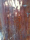 Rust on metal surface covered with paint. Rust on metal surface covered with peeling paint Stock Images