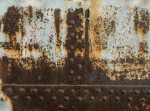 Rust metal texture with rivets, abstract grunge background royalty free stock photography