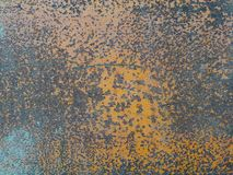 Rust metal texture Small rusty  bright orange and pale blue spots on iron wall. Rust metal texture stock images