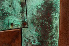Rust and Patina. Closeup of metal with green copper patina and rusted sections Stock Photos