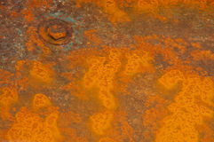 Rust Puddle. Rust pattern in puddle of a wheelbarrow Stock Photos