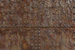 Rust on a sea door showing seams Stock Photo