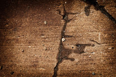 Rust Stained Concrete 3. A cracked and rust stained section of concrete sidewalk in disrepair. A great texture image for a background or overlay royalty free stock photo