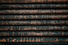 Rust steel tubes of the heat exchanger for maintenance, the water heater in the boiler as background. Manufacturing in Thailand royalty free stock images