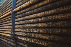 Rust steel tubes of the heat exchanger for maintenance, the water heater in the boiler as background. Manufacturing in Thailand royalty free stock photo